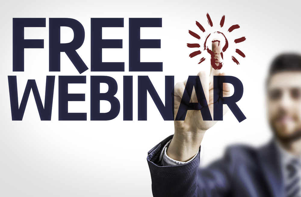 Business man pointing to transparent board with text Free Webinar